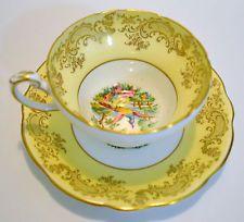E B FOLEY 1850 TEA CUP AND SAUCER YELLOW WITH BIRD MOTIF