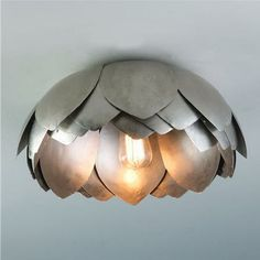 metal lotus contemporary ceiling lighting by Shades of Light. ( I hear no longer available. BUMMER.