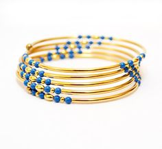 Blue and gold tube memory wire bracelet
