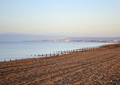 The Pevensey Bay Beach House | United kingdom Sussex England. Only the lap of the sea breaks the peace of this big bright beach house full of sunshine and views. Perfect for families and friends
