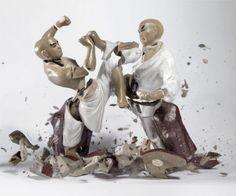 Photos of Porcelain Figurines Shattering into Countless Tiny Pieces