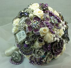 Bridal Brooch Bouquets mixed with silk. roses, amythest/purples