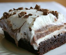 Brownie Refrigerator Cake. Brownie mix,egg, cream cheese, cool whip,  confectioners sugar, pudding.