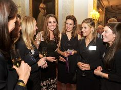 3. A GOOD SPORT photo | Kate Middleton talking here with some of Britain's Olympic and Paralympic medalists.
