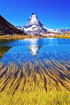 Reflections of Matterhorn | Switzerland   - Explore the World with Travel Nerd Nici, one Country at a Time. http://TravelNerdNici.com
