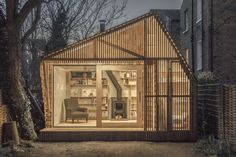 Writer's Shed by Weston Surman & Deane Architecture, London  Commissioned by an author/illustrator to design and build a writer's shed, WSD conceived a haven within the city; a fairytale hut at the end of a garden where the client can retreat and immerse himself in his work. The structure's glowing cedar facade, shingle cladding, log storage, and chimney all play a part in creating a mythical world for the client.