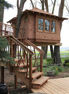 Treehouse sits nestled in a grove of Elm trees. Reclaimed Juniper branches from trees on the property bring a rustic appeal to to the deck and stairways.