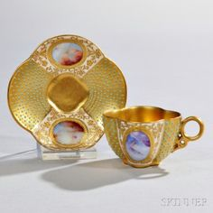 Jeweled Coalport Porcelain Quatrefoil-shaped Cup and Saucer, England, late 19th century