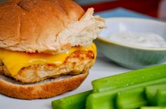 Buffalo Chicken burgers  1 lb ground chicken breast  1/2 teaspoon salt  1/2 teaspoon pepper  1/2 tablespoon italian seasoning  1/4 cup buffalo wing sauce  1/2 cup parmesan cheese  2 ounces sharp cheddar cheese    bacon ranch dressing + buffalo wing sauce for topping  4-6 whole wheat buns