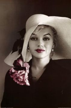 Nevr saw this pic before!  Marilyn Monroe in Floppy Hat with Flower Pin. Looks to be a hand tinted black and white photo. A wise girl kisses but doesnt love,  listens but doesnt believe, and leaves before she is left.  - Marilyn Monroe  Fear of commitment is a common theme for many men. Rare is the woman who loves them and leaves them. {ILoveMarilynMonroe} by VeeVa