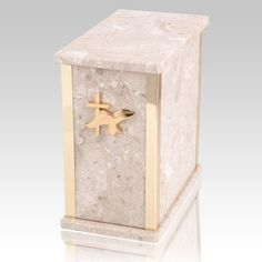 The Designer Perlato Agglomerate Marble Cremation Urn is assembled from real natural quarried stone. The urn has 24k gold plated decoration option and the bottom has felt to protect the surface were the urn rests. This wonderful natural stone urn will create a dignified resting place for eternity to come. Memorial Urns, Funeral Memorial, Cremation Urns, Natural Stones, Decorative Plates, Marble, Surface, Felt, Bronze