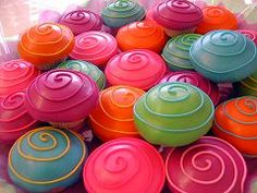 This brightly colored pile of swirly cupcakes is SO inviting!