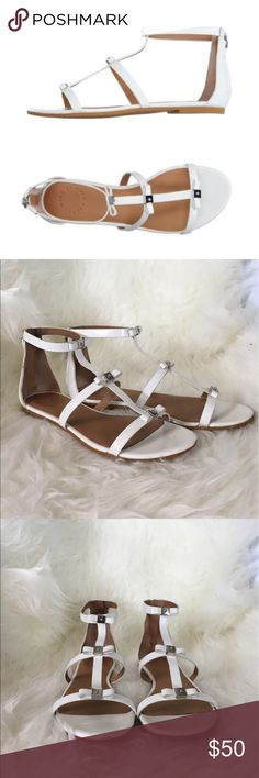 Women's White Bow T Strap Sandals Soft, polished leather, bow detailing, metal applications, solid color, zip closure, round toeline, leather lining, rubber cleated sole, flat, contains non-textile parts of animal origin. Small scuffs at toes but otherwise in excellent condition. Marc by Marc Jacobs Shoes Sandals