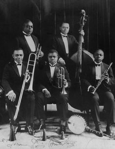 King Oliver (top left) and his Creole Jazz Band with his protégé Louis Armstrong front and center.