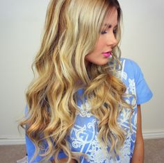 Loose curls made by wrapping small sections of hair around curling iron without the clamp