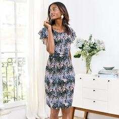 Soft Flutter-Sleeve Dress. Feminine sleeves with a flattering silhouette. This flutter-sleeve dress is all you need. With beautiful colors and an on-trend midi length, you'll love this dress. 👗