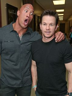 "Why so serious, Mark? Wahlberg keeps his cool next to a goofy Dwayne ""The Rock"" Johnson while in Las Vegas for the Paramount presentation at CinemaCon. http://www.people.com/people/gallery/0,,20799758,00.html"