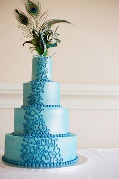 Normally I like the peacock thing to be brought in. I really do not care for it with this cake. But I love the shade of blue of the cake and, of course, the swirleys!