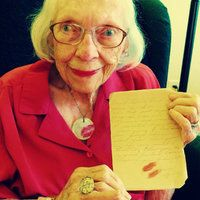 Grandma holding a letter that she wrote to my Grandpa during WWII while donning jewelry made from that very note.   Unique jewelry made from WWII love letters, or ANY handwritten items, for that matter!  Wearable art for all occasions!  Makes for great wedding jewelry, too. www.foreveryoursagnes.com