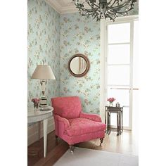 A fresh and beautiful living room! A luxurious vintage pink chair stands out magnificently against a floral wallpaper that's designed in the color of the sky - CW20302 Sky Dogwood Trail - Silana - Wisteria Cottage Wallpaper by Fairwinds Studios