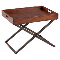 Display your favorite objet dart or cherished family photos atop this stylish design, an enviable addition to your home d�cor.Product: Coffee table       Construction Material: Metal and mahogany   Color: Distressed brown    Dimensions: 17.5 H x 24 W x 16.5 D    Cleaning and Care: Wipe with a clean, damp cloth