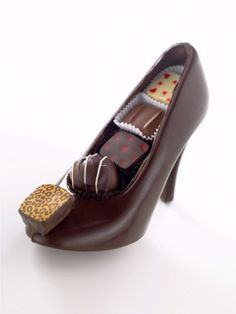 Chaussure a Talon -  $80.00 ea - chocolatbydaniel.com -  A special something for someone who has everything. All chocolate and completely edible. 8 inches long, 5 1/2 inches tall with a 3 1/2 inch heel, and full of superb chocolates. Even the leopard print accent is a truffle! Who said chocolate and fashion don't go together? - Not affordable for me, but isn't it a beauty?