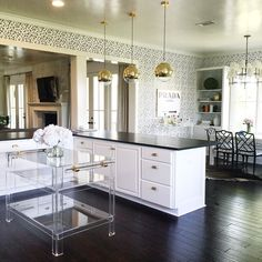 Gold drop lighting + lucite kitchen island