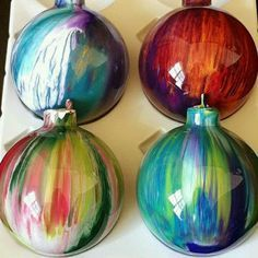 Make your own witch balls. A few drops of acrylic paint inside clear Christmas bulbs and shake :)