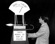 Mr. Abe Silverstein, Chief of the Wind Tunnel and Flight Research Division at the Aircraft Engine Research Laboratory of the National Advisory Committee for Aeronautics, Cleveland, Ohio, now known as John H. Glenn Research Center at Lewis Field, demonstrates the operation of a model ramjet aircraft engine.