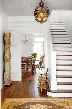 Magnificent modern farmhouse entry with wood floors, shiplap, and grandfather clock - found on Hello Lovely Studio