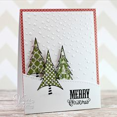 Use die/stamp tree set, texturize  snow.  Check background.  In kraft/green/white.