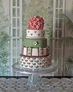 Green & Pink Vintage It's a combination of cut-out's, extruder and injector methods in fondant. Border bottom tier?