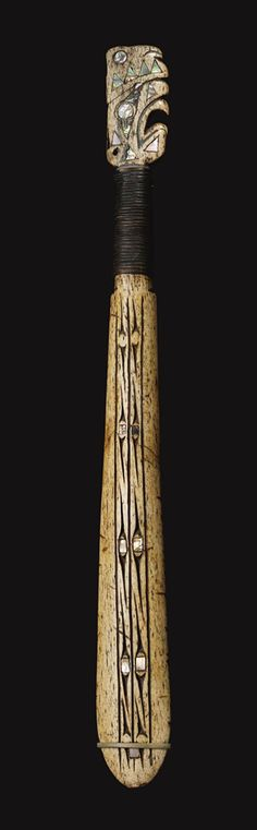 Whale-bone War Club.  Makah or Nuu'cha'nulth.  Abalone shell inlays.  Sotheby's auction