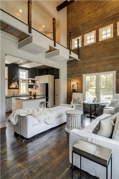 We love the open concept and high wooden wall.