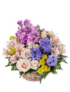 Adorable spring flower basket with pink & white alstroemeria, miniature spray roses, lavender stock, yellow button poms and blue hyacinth