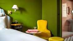 A clashing mix of pea-green walls, leopard-print furnishings and candy-striped beds feature in this hotel that British designer Luke Edward Hall has completed in Paris. Edward Hall, Orange Curtains, Printed Sofa, Cosy Room, Pink Tiles, Bright Decor, Colored Ceiling, Dark Furniture