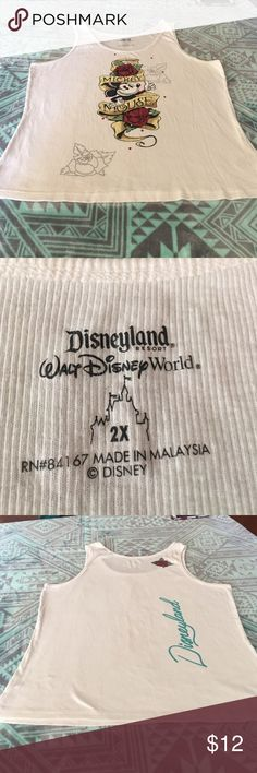 Mickey Mouse White Ribbed Tank! White mickey tank top. Has decals on front and back of tank pictured above. Size 2XL but fits more like a 1XL. Lightly worn. Disney Tops Tank Tops