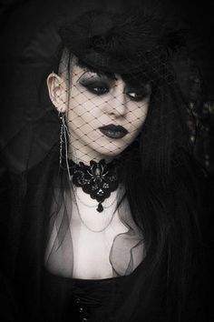 black widow gothic victorian fashion style for ball , halloween or everyday , love the viking inspired asymmetric long hair style with side shaven real punk tribal edge can be coupled with the more romantic styles #Goth girl in veil with sidecut #Gothic The Dark Side Fashion ♠️