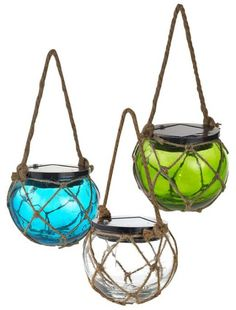Glass float hanging lanterns, solar powered. On sale. $6.99 each Featured here: http://www.completely-coastal.com/2012/05/coastal-lamps-inspired-by-fishing-glass.html