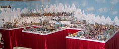A before and after of a Department 56 Christmas village display, using foam and Hot Wire Foam Factory tools.