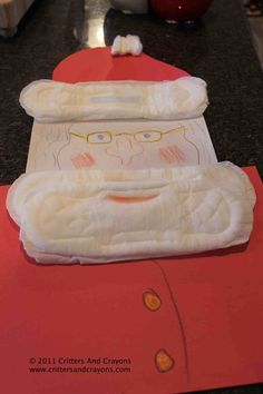 """The Maxi Pad Santa my husband and I made as part of an """"almost product review"""".  Part of a humor post.  :)"""