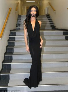 On the stairway to heaven: Conchita Wurst, pictured at a presentation event in Vienna...