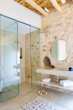 """Ibiza, Spain-based architecture and design studio Interiores designed CAN FRIT, a contemporary residence located in the island of Ibiza. """"This modern home was developed for an English family f… Bad Inspiration, Bathroom Inspiration, Interior Exterior, Interior Design, Modern Properties, Mediterranean Decor, Mediterranean Bathroom, Stone Houses, Beautiful Bathrooms"""