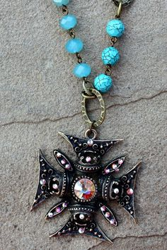 Save 10% by using promo code GUGREPBRITT at checkout! www.gugonline.com AB Crystal Chopper Cross on Turquoise and Chain Necklace