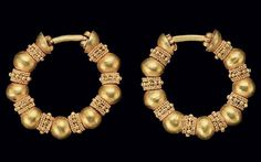A PAIR OF ACHAEMENID GOLD PENNANULAR EARRINGS LYDIA, CIRCA 5TH-4TH CENTURY B.C. Each composed of hollow spheres alternating with granulated rings, terminating at each end with a hemisphere joined to a hinged earwire