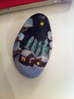 snowy setting cottage painted onto stone rock