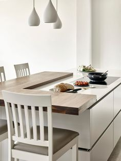 Split level island with integrated hob and bespoke bar stool seating. Contemporary Walnut and Cornforth white island design and breakfast bar. Apartment Kitchen, Kitchen Interior, Kitchen Decor, Kitchen Ideas, Cafe Interior, Interior Doors, Kitchen Tips, Interior Design, Kitchen Stools