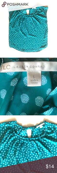 "LC Lauren Conrad Teal Polka Dot Blouse Teal top by LC Lauren Conrad. Pleated around neckline and ties in a bow at back neck. Size Large. Approx measurements lying flat: 22.5"" bust, 25"" length. Excellent condition.   •Lowball offers declined •no trades •ask all questions before buying •unfair ratings from buyers are reported & buyer will be blocked - I don't misrepresent my products; what you see is what you get. Please be kind as I always strive to be kind to you! LC Lauren Conrad Tops…"