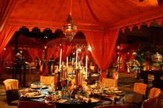 by Raj Tents for David Tutera's My Fair Wedding show on WE TV:  The concept was a belly-dancing wedding.  The bride was a Persian Jew, the groom a Vietnamese/Chinese who'd converted to Judaism.  The food Kosher and ceremony Jewish.  This show was a delight to watch.  If you don't catch it, take a look a the reception...truly a grand affair!