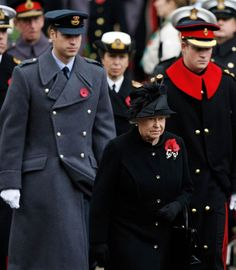 Solemn occasion Britain's Queen Elizabeth II, center, and her grandsons Prince William, left, and Prince Harry, right, attend the annual Remembrance Sunday ceremony at the cenotaph in London, on, Nov. 8, 2009. Queen Elizabeth II led Britain's annual ceremony for the country's war dead, honoring them with a moment of silence as the military reported the 200th British soldier killed in combat in Afghanistan.